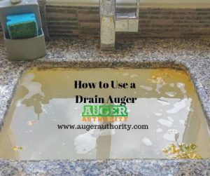 how to use a drain auger